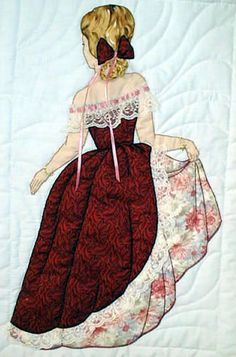 "#8 ""Bonnet Girl Relatives & Friends"" Elizabeth $6.50.  Elizabeth is holding her skirt to keep the appliqué lace trim out of the dirt.  Her embroidery hair is trimmed with an appliqué bow and ribbon."