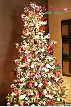 Candy cane theme tree.  This lady changes the theme of her tree EVERY year.  I'd love to be able to do that too.