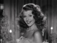 Rita Hayworth as Claire. (I believe Claire, coming from the 1940's would have this feeling of beauty---and that's some wild hair!)
