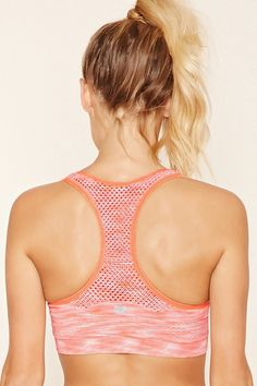 f9c1a94fdefd2 A space dye low-impact sports bra crafted from seamless knit with a  perforated racerback