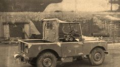 R01 outside camouflaged Rover factory.