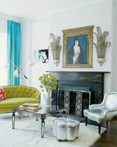 The antique love seat in the master bedroom is upholstered in a Scalamandré fabric; the British Flag pillow and Utopia Bird vase are by Jonathan Adler, the curtains are made of a Clarence House linen, and the sconces are vintage.