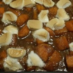 Sweet potatoes are parboiled and then baked with a sweet sauce of margarine, brown sugar, marshmallows, cinnamon and nutmeg.