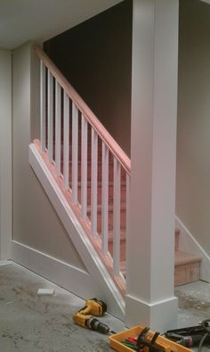 Basement Stair - removing part of the wall and replacing it with spindles and handrail makes the basement feel more like a lower level than a basement.