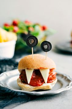 Four easy, & creative Halloween appetizers: Spiderweb 7-Layer Dip, Walking Dead Mummy Dogs, Monster Meatball Sliders, & Cheesy Monster Fingernail Bread.