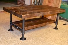 Extra nice pallet wood coffee table with plumbing pipe legs and crossbars