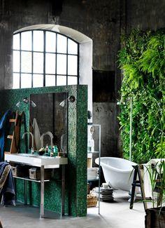 Tub room open, window, plant wall, shower head with river rock below all open