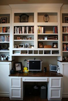 built in bookshelves with built-in desk that protrudes out a bit. For phase 2 of the office when the kids are older and need homework spots.