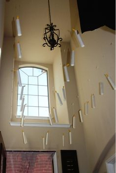 """Great Hall floating candles (5""""x8"""" paper rolled up, yellow crepe paper """"flame"""", hung by fishing wire)"""