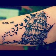 Fashioned pirate ship tattoo