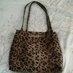 Leppard purse Medium size nine west Leppard purse.. Been used a few times but is very clean. Nine West Bags