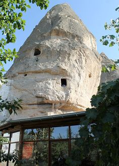Yasin's Place: the Cave Hotel  Location: Cappadocia, Turkey  The guest rooms at Yasin's Place are found in an authentic Cappadocian cave house. Thousands of years ago humans began carving homes into the region's rocks and fairy chimneys, some of which are still used today. The Cave Hotel still shows signs of these former uses and aims to give travellers a taste of life as a cave-dweller. Guests can stay in the kitchen, the winery, or even the pigeon coop.  www.backpackerscavehotel.com
