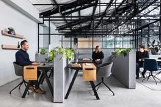 A dynamic warehouse conversion in Melbourne, Victoria, Australia, allows two creative businesses to share a boardroom and break area in a homey, Art Deco-inspired space.