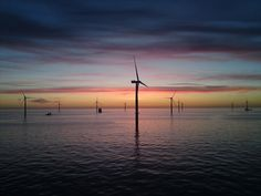 Sunset Over Offshore Wind Farm.