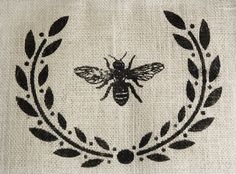 I need to make a wreath based on this for my living room when I decide on a color scheme.  I freaking love bees.