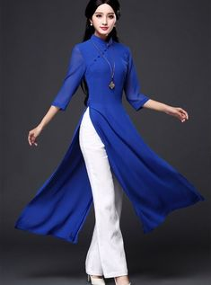 Blue tunic while pants Blue tunic while pants Muslim Fashion, Hijab Fashion, Fashion Dresses, Traditional Fashion, Traditional Dresses, Traditional Chinese, Vietnamese Traditional Dress, Ao Dai, Kurta Designs