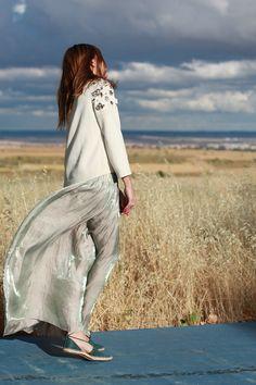 "#ESCADAEscapes: Blogger @mientrasmevisto wearing ESCADA Sport skirt ""Replissee"" and sweater ""Sekka"""