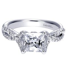 Gorgeous 1 carat diamond princess cut engagement ring with diamonds on the band and a fancy detail on the band.