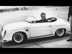 James Dean the Giant driving his racecar
