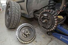 The DC brushless motor is mounted to a car's rear wheel.credit: physorg.com Dr. Charles Perry, former IBM engineer, had devised a kit that turns any car in