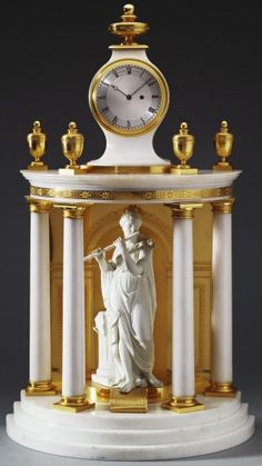 "1790 British Clock in the Royal Collection, UK - From the curators' comments: ""Vulliamy was commissioned to make this elegant neo-classical 'temple' clock for Queen Charlotte: the King and Prince of Wales already each possessed at least one Vulliamy clock with a Derby biscuit figure ornamenting the case. The case is of white marble surmounted by ormolu vases and the clock case which itself is surmounted by a stylised finial."""