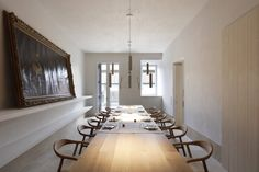 In the dining room: A custom 20-foot-long oak dining table from Carl Hansen seats 20.