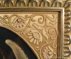 Exquisite beadwork embroidery in a gold frame designed and stitched by Larissa Borodich.
