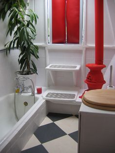 cute boat bathroom - sunken tub, compost toilet on a box seat, and a tiny woodstove!!