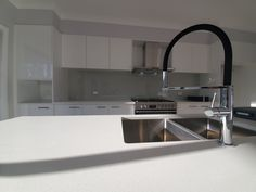 An Attractive Black Goose Neck Hose To Compliment Your Kitchen Look