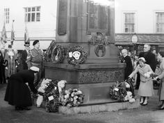 Remembrance service at Stourbridge War Memorial, 1957. The memorial was outside the Old Stourbridge Library at the time, later moved to Mary Stevens Park