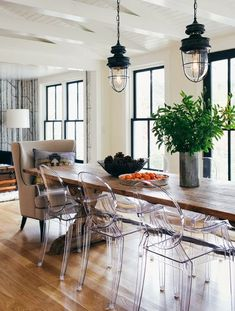 Wood table, ghost chairs, upholstered arm chairs