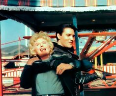 """Barbara Stanwyck and Elvis having fun on the """"Roustabout movie set."""