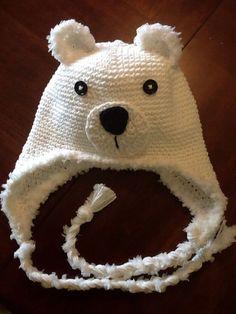 White polar bear hat with fur trim.