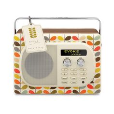Orla Kiely: Designer Portable Digital and FM Radio    Introducing the latest addition to our extensive home ware range, the exterior boasts a choice of prints, a mirror chromed folding handle, walnut veneered cabinet, cream fascia and a stylish leather tag on the multi colourway.  It is packed with features too, including digital and FM radio, an input for your iPod/MP3 player, Intellitext and textSCAN, a striking auto-dimming OLED display, an alarm, a kitchen timer and a USB connector for…