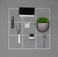 monochrome concrete office | Nordic workspace | grayscale work space | metal wire wall grid | black and white mesh memo board | 9 square grid bulletin board by wallment | wall basket | vertical gardening | plant wall | Finnish design object | smart storage | Scandi style #anslagstavla #homeoffice