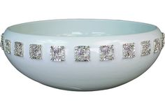 Jeweled Bath Sinks, vintage jewelry is reproduced and affixed to the porcelin sink.  Not sure...