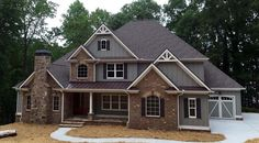 Craftsman Style House Plan 50263 offers square feet of living space with 4 bedrooms and 4 bathrooms. The front façade shows an attractive combination of materials including vertical siding, brick and stone. Decorative gables and metal roof accents c Family House Plans, Country House Plans, Dream House Plans, House Floor Plans, Dream Houses, Brick House Colors, Exterior House Colors, Gray Exterior, Exterior Siding