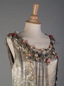 Dress (details) by Boué Soeurs, 1928.Brocade silver lame, blue net, silk floral trim, sequins.  Image c. Kent State University Museum.