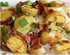 Slow Cooker Bacon Cheese Potatoes - this slow cooker side dish recipe is a savory dish of heaven, made with bacon, onions, Cheddar cheese, butter and more.