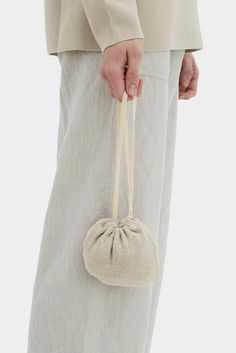 Read about Design & Production Linen shopper is made of crash linen and features cotton label. There is a inside pocket which can be used as the bag ca Textile Dyeing, Potli Bags, Bag Packaging, Malva, Linen Bag, Minimalist Wallet, Beaded Bags, Clothing Labels, Summer Bags