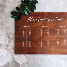Classic wooden hand lettered wedding table seating sign.