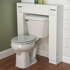 Over Toilet Cabinet. This clever and versatile bathroom space saver from Simple Living allows you to utilize extra space for all your bathroom storage needs. Space saver includes a center cabinet and two side cabinets. Over The Toilet Cabinet, Bathroom Storage Over Toilet, Toilet Storage, Bathroom Organization, Budget Organization, Bathroom Laundry, Bathroom Towels, White Bathroom, Bathroom Cabinets