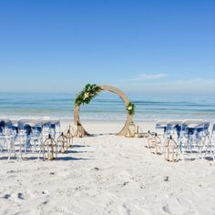 The circle of love arch is available as beach decor from FloridaWeddings in certain packages.