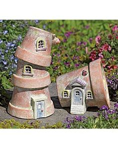 flower pot houses. great for a fairy garden. not a diy but a good idea for creating with the use of Fimo for doors perhaps