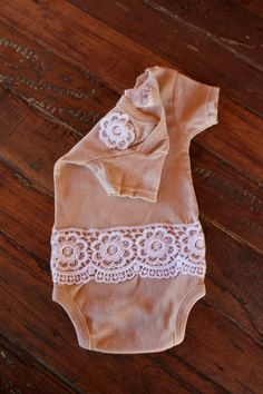 Lace on onesie--looks like a white tea died onsie..adding embellishments should be easy peasy...so cute for a vintage look :)