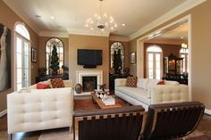 Contemporary living room mixing mid-century mod furnishings with traditional home architecture
