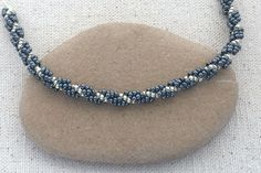Learn how to make a spiral bead rope with this free step by step tutorial. A perfect stitch for bracelets, necklaces, purse straps and much more.