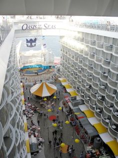 Oasis of the Seas | Balcony Boardwalk rooms offer a full view of the robust activities happening at all times on this Oasis Class boardwalk.