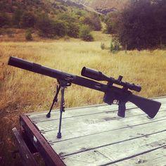 Suppessed Ar15 heavy barrel varmint rifle with 6-24x50 Swarovski glass.