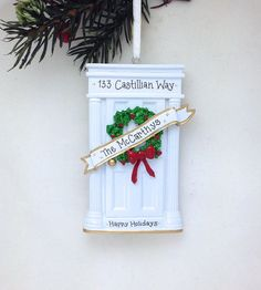 Ornament comes BLANK and will be hand-personalized with writing according to your instructions on the checkout screen -- including names, messages, and year, if requested. Click through the photos to see what the ornament looks like without sample personalization. Elegant white door